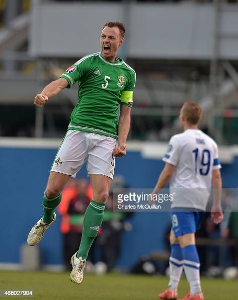 Jonny Evans of Northern Ireland celebrates after the EURO 2016 Group F qualifier at Windsor Park on March 29 2015 in Belfast Northern Ireland