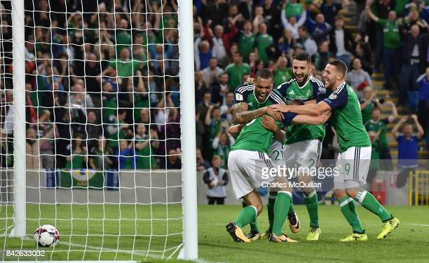 Jonny Evans of Northern Ireland celebrates with team mates after scoring during the FIFA 2018 World Cup Qualifier between Northern Ireland and Czech...