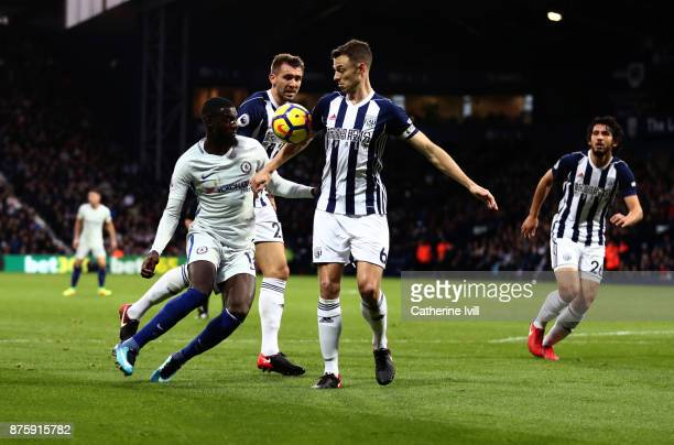 Jonny Evans of West Bromwich Albion appears to handle the ball as Tiemoue Bakayoko of Chelsea and Gareth McAuley of West Bromwich Albion look on...