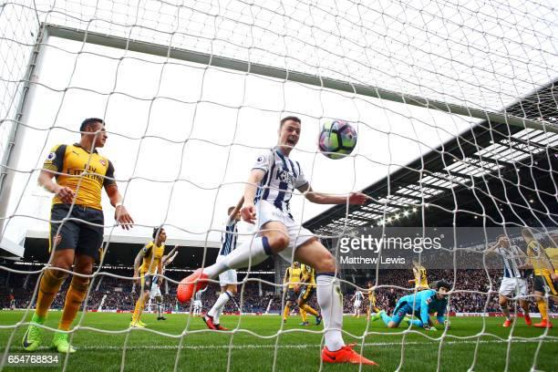 Jonny Evans of West Bromwich Albion celebrates as Craig Dawson of West Bromwich Albion scores his sides first goal during the Premier League match...