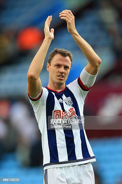 Jonny Evans of West Bromwich Albion celebrates his team's 10 win in the Barclays Premier League match between Aston Villa and West Bromwich Albion at...