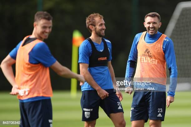Jonny Evans of West Bromwich Albion Craig Dawson of West Bromwich Albion and Gareth McAuley of West Bromwich Albion share a joke on September 7 2017...