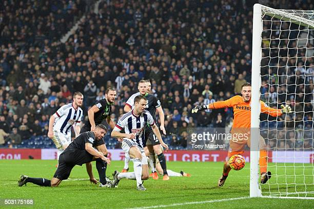 Jonny Evans of West Bromwich Albion scores his team's second goal during the Barclays Premier League match between West Bromwich Albion and Stoke...