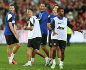 Jonny Evans Ryan Giggs Rio Ferdinand Adnan Januzaj and Patrice Evra of Manchester United in action during a first team training session as part of...