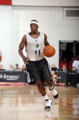 Jonny Flynn of the Minnesota Timberwolves brings the ball up court against the NBA DLeague Select Team during NBA Summer League presented by EA...