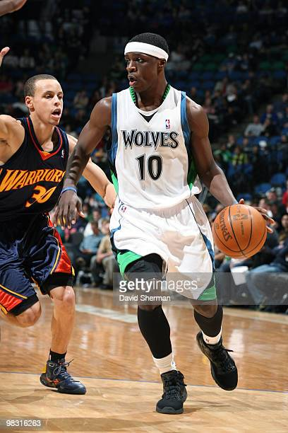 Jonny Flynn of the Minnesota Timberwolves moves the ball against Stephen Curry of the Golden State Warriors during the game on April 7 2010 at the...