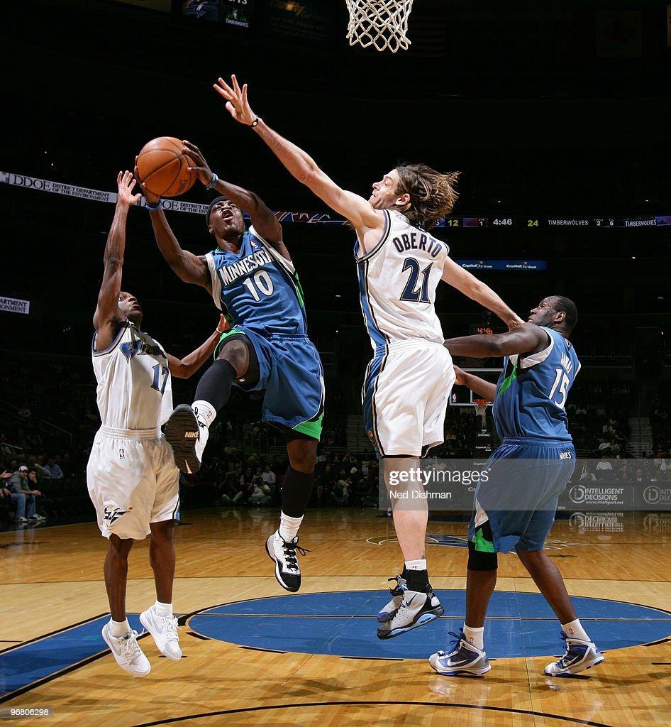 Jonny Flynn #10 of the Minnesota Timberwolves shoots against Earl Boykins #12 and Fabricio Oberto #21 of the Washington Wizards at the Verizon Center on February 17, 2010 in Washington, DC.