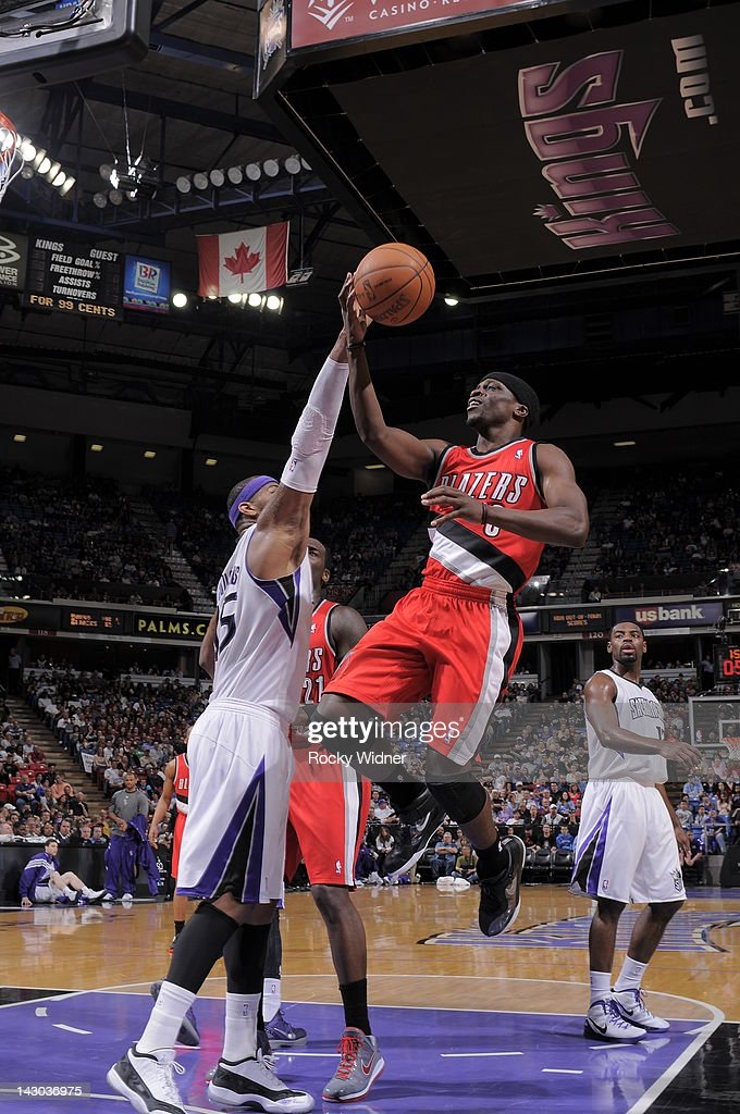 Jonny Flynn #3 of the Portland Trail Blazers shoots the ball against <a gi-track='captionPersonalityLinkClicked' href=/galleries/search?phrase=DeMarcus+Cousins&family=editorial&specificpeople=5792008 ng-click='$event.stopPropagation()'>DeMarcus Cousins</a> #15 of the Sacramento Kings on April 15, 2012 at Power Balance Pavilion in Sacramento, California.