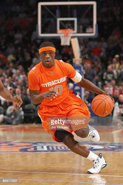 Jonny Flynn of the Syracuse Orange dribbles the ball against the Connecticut Huskies during the quarterfinals of the Big East Tournament at Madison...