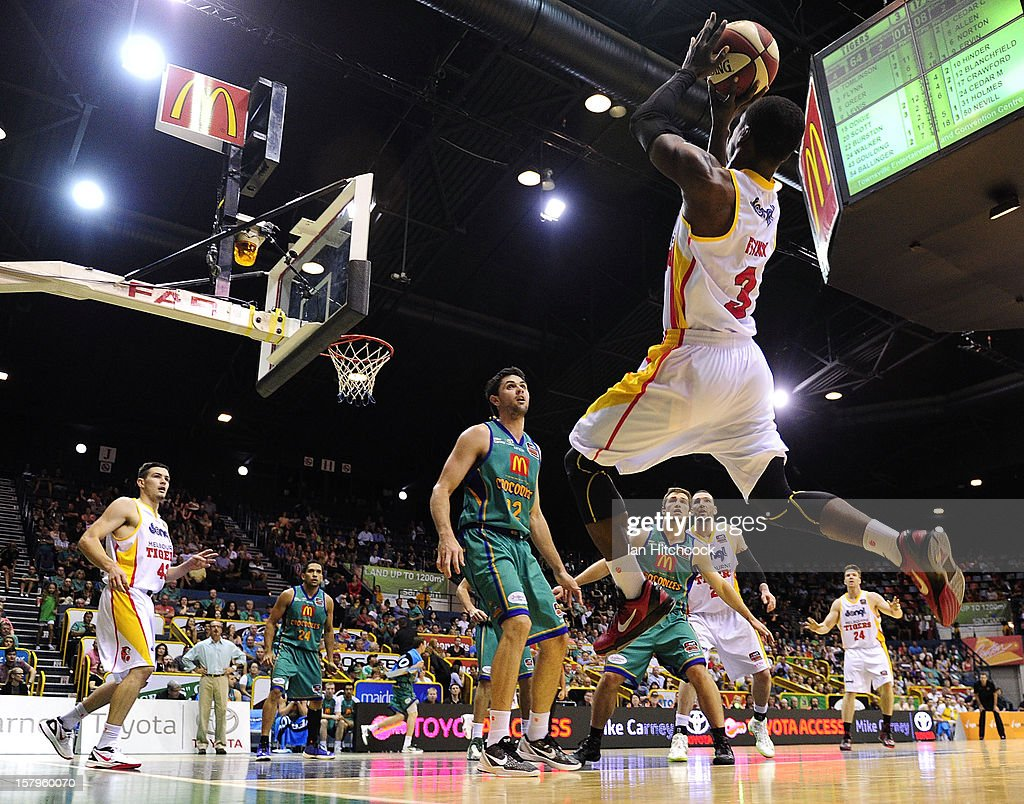 Jonny Flynn of the Tigers attempts a jump shot during the round ten NBL match between the Townsville Crocodiles and the Melbourne Tigers at Townsville Entertainment Centre on December 8, 2012 in Townsville, Australia.