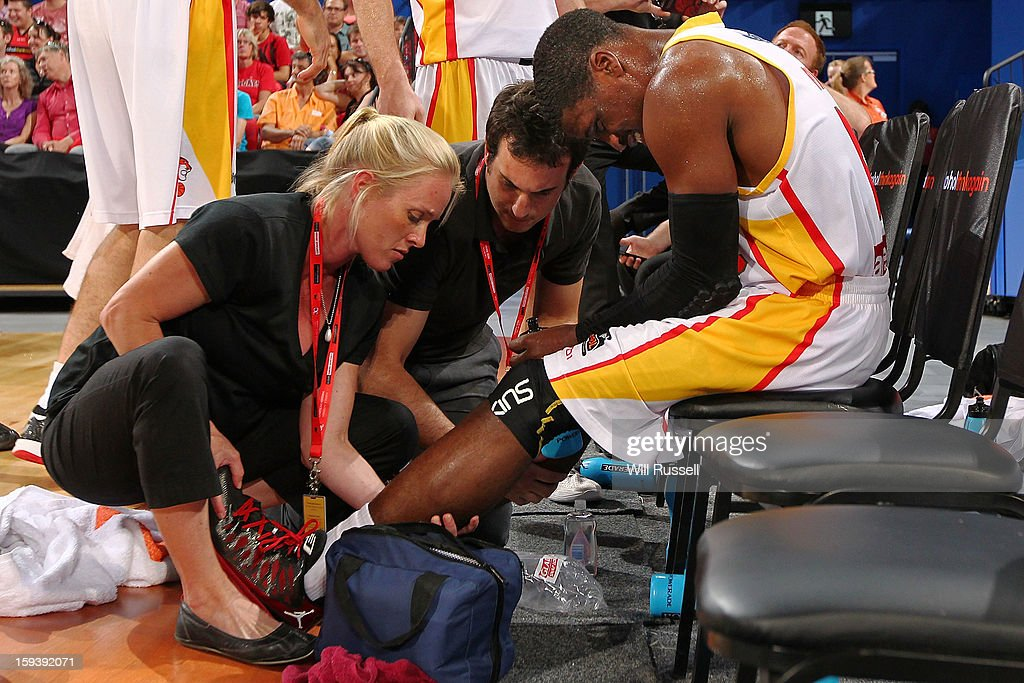 Jonny Flynn of the Tigers has his leg checked by trainers during the round 14 NBL match between the Perth Wildcats and the Melbourne Tigers at Perth Arena on January 13, 2013 in Perth, Australia.