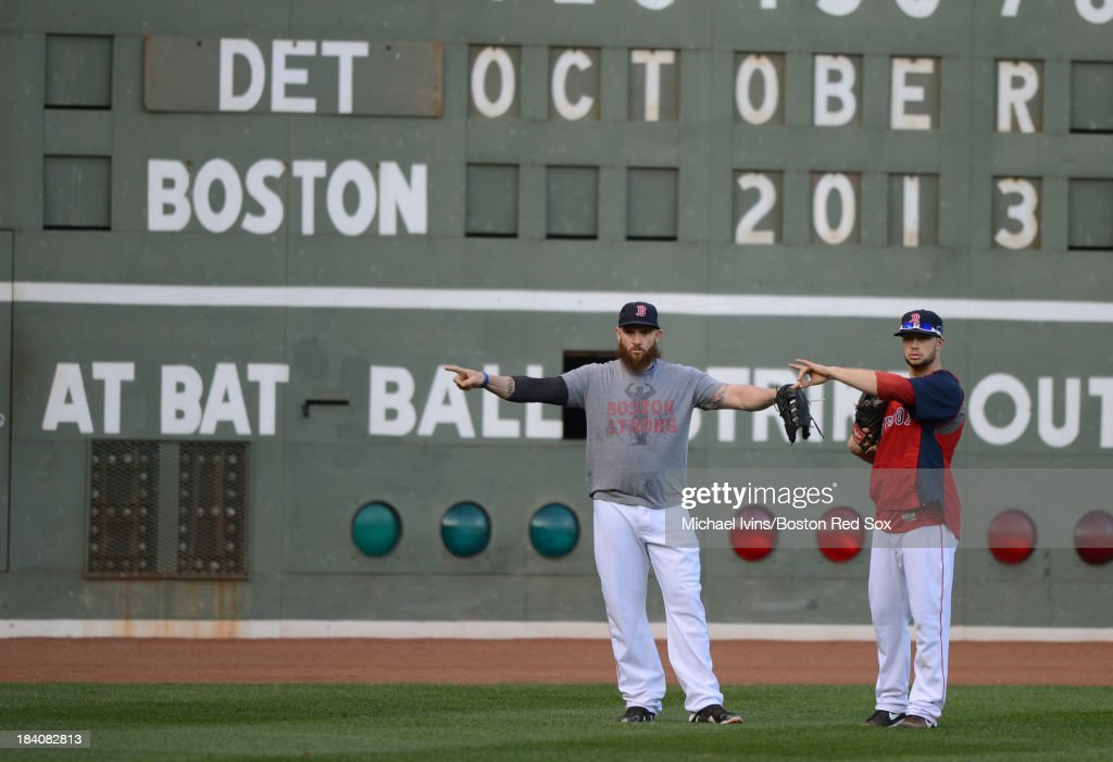 <a gi-track='captionPersonalityLinkClicked' href=/galleries/search?phrase=Jonny+Gomes&family=editorial&specificpeople=568435 ng-click='$event.stopPropagation()'>Jonny Gomes</a> #5 and <a gi-track='captionPersonalityLinkClicked' href=/galleries/search?phrase=Daniel+Nava&family=editorial&specificpeople=670454 ng-click='$event.stopPropagation()'>Daniel Nava</a> #29 of the Boston Red Sox participate in a workout a day before the American League Championship Series against the Detroit Tigers on October 11, 2013 at Fenway Park in Boston, Masschusetts.