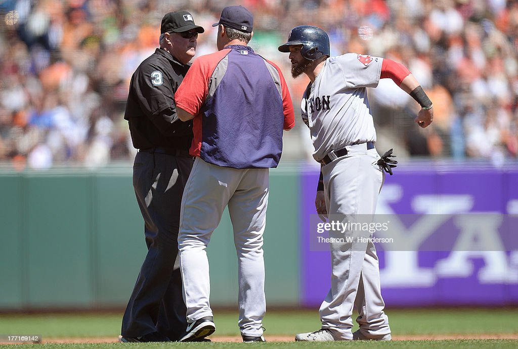 <a gi-track='captionPersonalityLinkClicked' href=/galleries/search?phrase=Jonny+Gomes&family=editorial&specificpeople=568435 ng-click='$event.stopPropagation()'>Jonny Gomes</a> #5 and manager John Farrell #53 argues with second base umpire <a gi-track='captionPersonalityLinkClicked' href=/galleries/search?phrase=Tim+Welke&family=editorial&specificpeople=224714 ng-click='$event.stopPropagation()'>Tim Welke</a> #3 over Gomes being called out when coming off the base and tagged by Marco Scutaro #19 (not pictured) of the San Francisco Giants in the third inning at AT&T Park on August 21, 2013 in San Francisco, California.