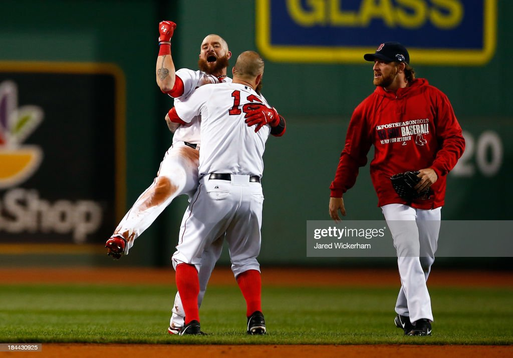 <a gi-track='captionPersonalityLinkClicked' href=/galleries/search?phrase=Jonny+Gomes&family=editorial&specificpeople=568435 ng-click='$event.stopPropagation()'>Jonny Gomes</a> #5 and <a gi-track='captionPersonalityLinkClicked' href=/galleries/search?phrase=Mike+Napoli&family=editorial&specificpeople=525007 ng-click='$event.stopPropagation()'>Mike Napoli</a> #12 of the Boston Red Sox celebrate after defeating the Detroit Tigers 6-5 in Game Two of the American League Championship Series at Fenway Park on October 13, 2013 in Boston, Massachusetts.