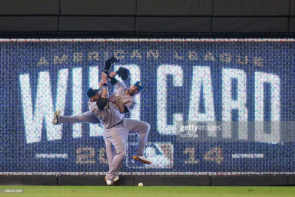 <a gi-track='captionPersonalityLinkClicked' href=/galleries/search?phrase=Jonny+Gomes&family=editorial&specificpeople=568435 ng-click='$event.stopPropagation()'>Jonny Gomes</a> #15 and <a gi-track='captionPersonalityLinkClicked' href=/galleries/search?phrase=Sam+Fuld&family=editorial&specificpeople=4505687 ng-click='$event.stopPropagation()'>Sam Fuld</a> #23 of the Oakland Athletics collide on a triple hit by Eric Hosmer #35 of the Kansas City Royals in the 12th inning during the American League Wild Card game at Kauffman Stadium on September 30, 2014 in Kansas City, Missouri.