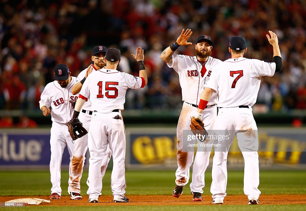 <a gi-track='captionPersonalityLinkClicked' href=/galleries/search?phrase=Jonny+Gomes&family=editorial&specificpeople=568435 ng-click='$event.stopPropagation()'>Jonny Gomes</a> #5 and <a gi-track='captionPersonalityLinkClicked' href=/galleries/search?phrase=Stephen+Drew&family=editorial&specificpeople=757520 ng-click='$event.stopPropagation()'>Stephen Drew</a> #7 of the Boston Red Sox celebrate after defeating the Tampa Bay Rays 7-4 in Game Two of the American League Division Series at Fenway Park on October 5, 2013 in Boston, Massachusetts.