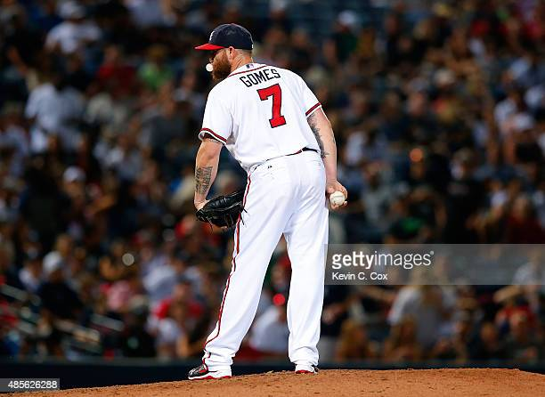 Jonny Gomes of the Atlanta Braves pitches in the ninth inning to the New York Yankees at Turner Field on August 28 2015 in Atlanta Georgia