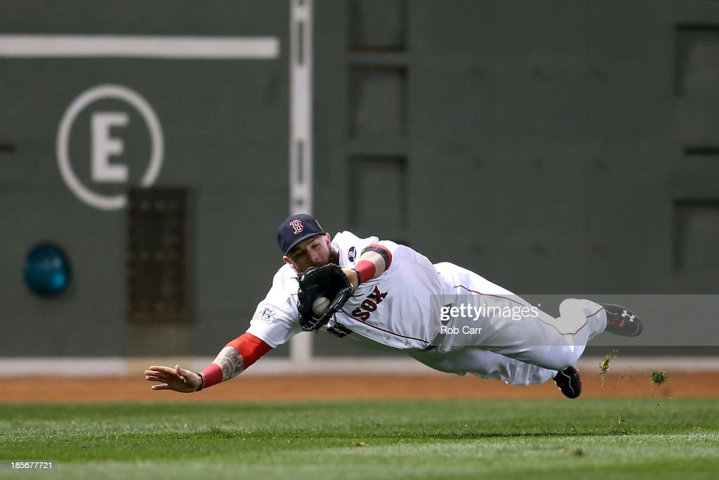 <a gi-track='captionPersonalityLinkClicked' href=/galleries/search?phrase=Jonny+Gomes&family=editorial&specificpeople=568435 ng-click='$event.stopPropagation()'>Jonny Gomes</a> #5 of the Boston Red Sox catches a ball hit by Matt Adams #53 of the St. Louis Cardinals in the fifth inning of Game One of the 2013 World Series at Fenway Park on October 23, 2013 in Boston, Massachusetts.