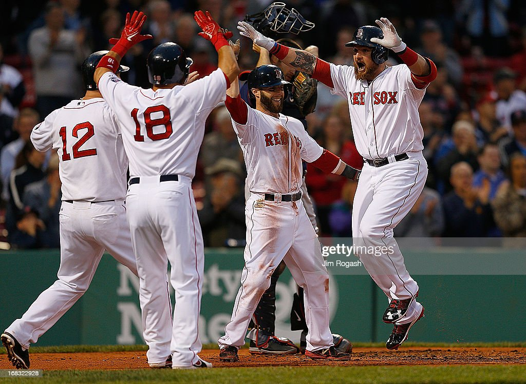 <a gi-track='captionPersonalityLinkClicked' href=/galleries/search?phrase=Jonny+Gomes&family=editorial&specificpeople=568435 ng-click='$event.stopPropagation()'>Jonny Gomes</a> #5 of the Boston Red Sox celebrates with <a gi-track='captionPersonalityLinkClicked' href=/galleries/search?phrase=Dustin+Pedroia&family=editorial&specificpeople=836339 ng-click='$event.stopPropagation()'>Dustin Pedroia</a> #15, <a gi-track='captionPersonalityLinkClicked' href=/galleries/search?phrase=Mike+Napoli&family=editorial&specificpeople=525007 ng-click='$event.stopPropagation()'>Mike Napoli</a> #12, and <a gi-track='captionPersonalityLinkClicked' href=/galleries/search?phrase=Shane+Victorino&family=editorial&specificpeople=576251 ng-click='$event.stopPropagation()'>Shane Victorino</a> #18 after he hit a grand slam home run in the first inning against the Minnesota Twins at Fenway Park on May 8, 2013 in Boston, Massachusetts.
