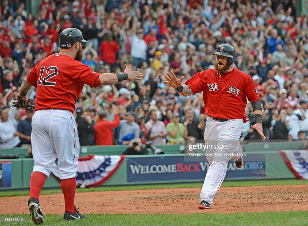 <a gi-track='captionPersonalityLinkClicked' href=/galleries/search?phrase=Jonny+Gomes&family=editorial&specificpeople=568435 ng-click='$event.stopPropagation()'>Jonny Gomes</a> #5 of the Boston Red Sox celebrates with <a gi-track='captionPersonalityLinkClicked' href=/galleries/search?phrase=Mike+Napoli&family=editorial&specificpeople=525007 ng-click='$event.stopPropagation()'>Mike Napoli</a> #12 after scoring a run against the Tampa Bay Rays during the fifth inning of game one of the American League Division Series on October 4, 2013 at Fenway Park in Boston, Massachusetts.