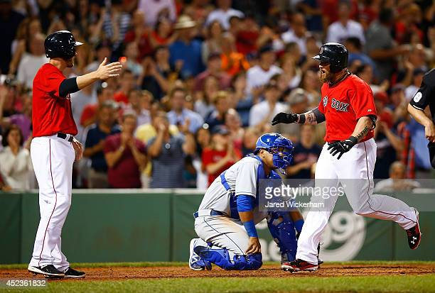 Jonny Gomes of the Boston Red Sox celebrates with teammate Stephen Drew after hitting the goahead tworun home run in the sixth inning against the...