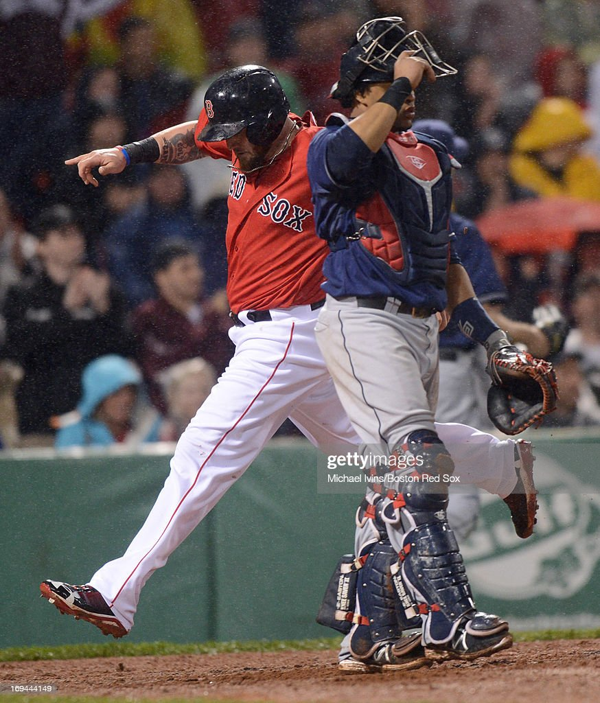 <a gi-track='captionPersonalityLinkClicked' href=/galleries/search?phrase=Jonny+Gomes&family=editorial&specificpeople=568435 ng-click='$event.stopPropagation()'>Jonny Gomes</a> #5 of the Boston Red Sox crosses home plate behind Carlos Santana #41 of the Cleveland Indians in the seventh inning on May 24, 2013 at Fenway Park in Boston, Massachusetts.