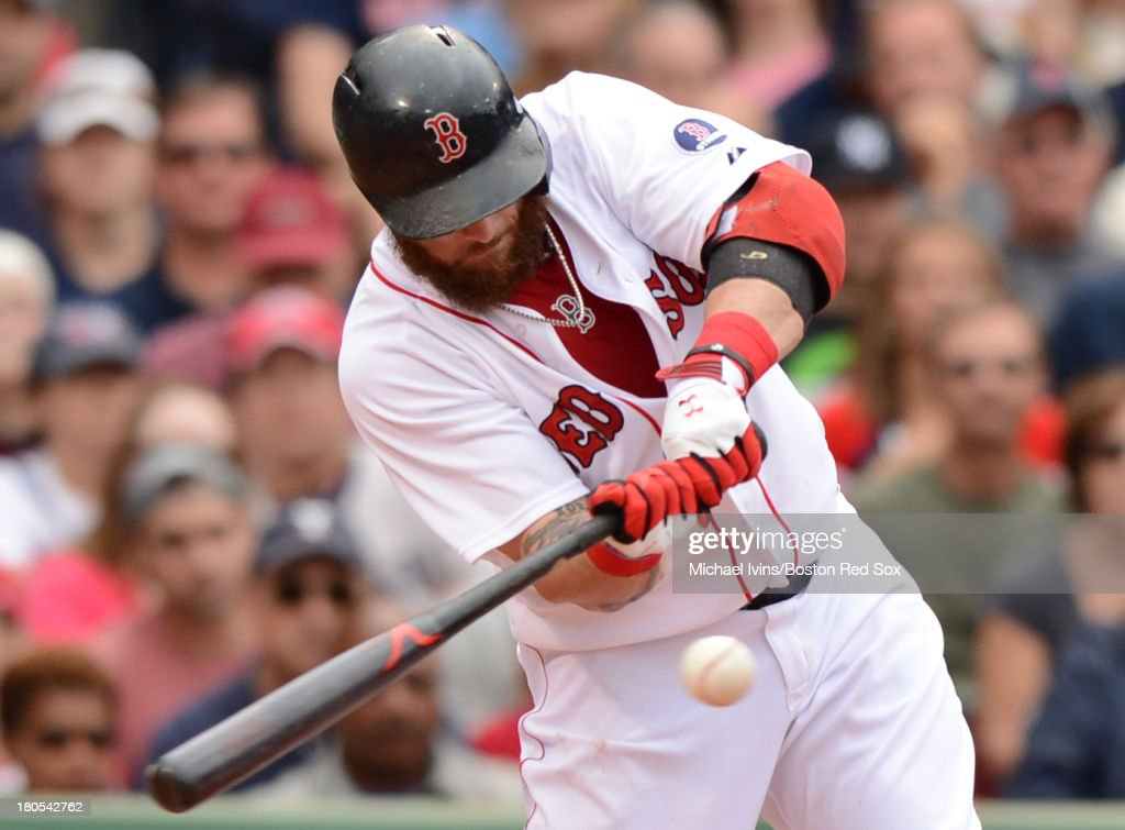 Jonny Gomes #5 of the Boston Red Sox hits a double against the New York Yankees during the fifth inning on September 14, 2013 at Fenway Park in Boston Massachusetts.