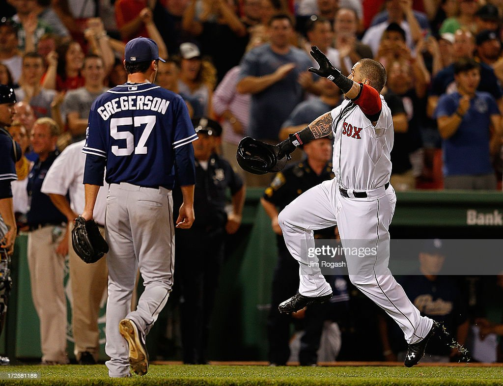 Jonny Gomes #5 of the Boston Red Sox reacts after he hit a walk-off home run from a pitch by Victor Rodriguez #57 of the Boston Red Sox to give the Red Sox a 2-1 win against the San Diego Padres at Fenway Park on July 3, 2013 in Boston, Massachusetts.