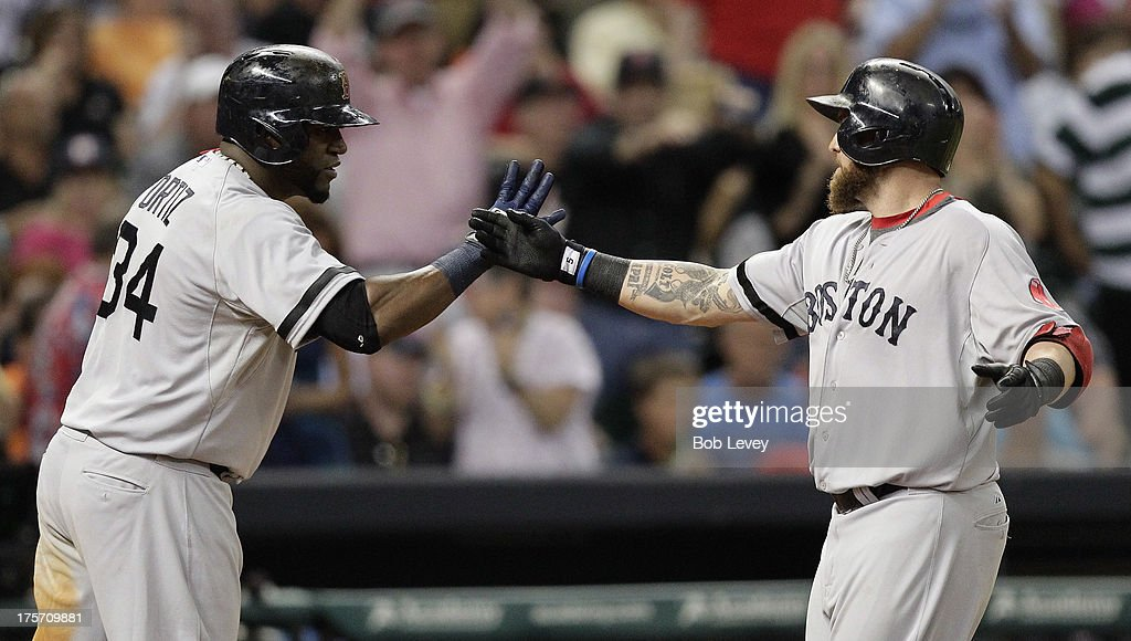 <a gi-track='captionPersonalityLinkClicked' href=/galleries/search?phrase=Jonny+Gomes&family=editorial&specificpeople=568435 ng-click='$event.stopPropagation()'>Jonny Gomes</a> #5 of the Boston Red Sox receives congratulations from <a gi-track='captionPersonalityLinkClicked' href=/galleries/search?phrase=David+Ortiz&family=editorial&specificpeople=175825 ng-click='$event.stopPropagation()'>David Ortiz</a> #34 after hitting a three run home run in the sixth inning against the Houston Astros at Minute Maid Park on August 6, 2013 in Houston, Texas.