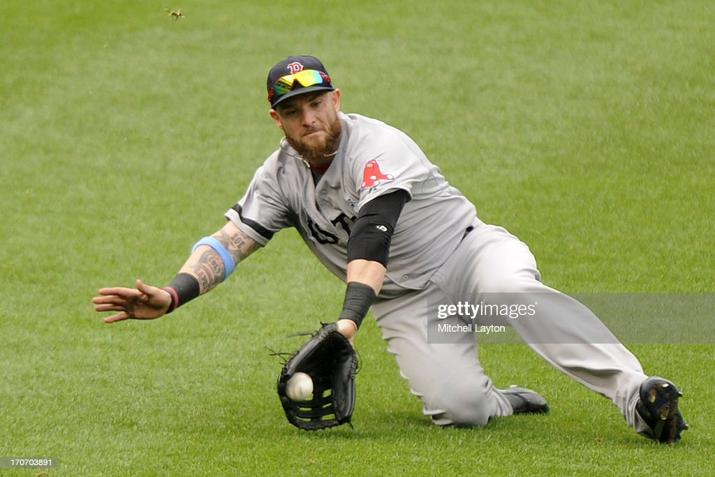 <a gi-track='captionPersonalityLinkClicked' href=/galleries/search?phrase=Jonny+Gomes&family=editorial&specificpeople=568435 ng-click='$event.stopPropagation()'>Jonny Gomes</a> #5 of the Boston Red Sox slides to catch a fly ball hit by Steve Pearce #28 of the Baltimore Orioles the sixth inning during a baseball game on June 16, 2013 at Oriole Park at Camden Yards in Baltimore, Maryland.