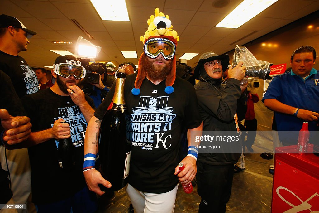 <a gi-track='captionPersonalityLinkClicked' href=/galleries/search?phrase=Jonny+Gomes&family=editorial&specificpeople=568435 ng-click='$event.stopPropagation()'>Jonny Gomes</a> #31 of the Kansas City Royals celebrates with teammates in the clubhouse after defeating the Houston Astros 7-2 in game five of the American League Divison Series at Kauffman Stadium on October 14, 2015 in Kansas City, Missouri.