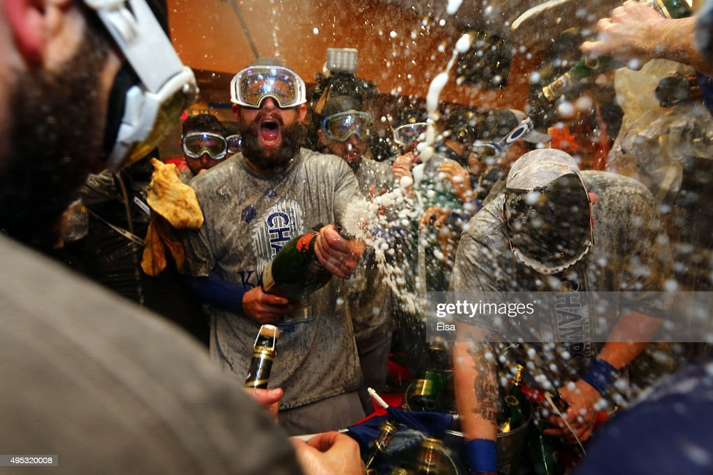 Jonny Gomes #31 of the Kansas City Royals celebrates with teammates in the clubhouse after defeating the New York Mets to win Game Five of the 2015 World Series at Citi Field on November 1, 2015 in the Flushing neighborhood of the Queens borough of New York City. The Kansas City Royals defeated the New York Mets with a score of 7 to 2 to win the World Series.