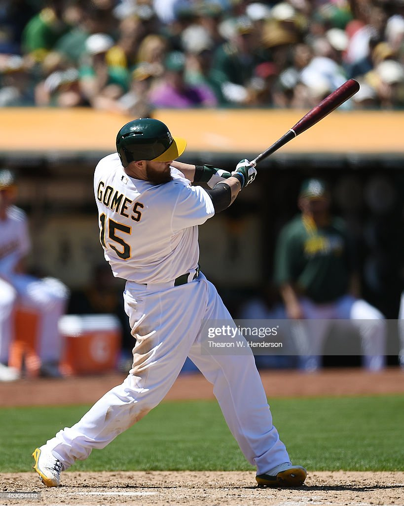 <a gi-track='captionPersonalityLinkClicked' href=/galleries/search?phrase=Jonny+Gomes&family=editorial&specificpeople=568435 ng-click='$event.stopPropagation()'>Jonny Gomes</a> #15 of the Oakland Athletics hits a bases loaded two-run single against the Kansas City Royals in the bottom of the fifth inning at O.co Coliseum on August 2, 2014 in Oakland, California.