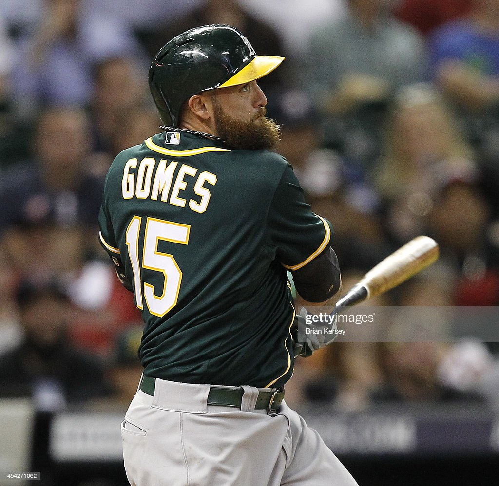 <a gi-track='captionPersonalityLinkClicked' href=/galleries/search?phrase=Jonny+Gomes&family=editorial&specificpeople=568435 ng-click='$event.stopPropagation()'>Jonny Gomes</a> #15 of the Oakland Athletics hits a sacrifice fly in the sixth inning against the Houston Astros at Minute Maid Park on August 27, 2014 in Houston, Texas.