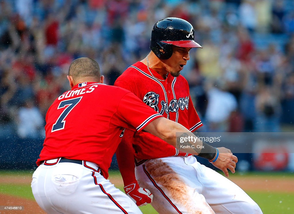 <a gi-track='captionPersonalityLinkClicked' href=/galleries/search?phrase=Jonny+Gomes&family=editorial&specificpeople=568435 ng-click='$event.stopPropagation()'>Jonny Gomes</a> #7 tackles <a gi-track='captionPersonalityLinkClicked' href=/galleries/search?phrase=Jace+Peterson&family=editorial&specificpeople=7265898 ng-click='$event.stopPropagation()'>Jace Peterson</a> #8 of the Atlanta Braves after he hit a walk-off RBI single in the 11th inning against the Milwaukee Brewers at Turner Field on May 23, 2015 in Atlanta, Georgia. The Braves win 3-2.