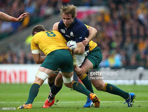 Jonny Gray of Scotland is tackled by Ben McCalman of Australia during the 2015 Rugby World Cup Quarter Final match between Australia and Scotland at...