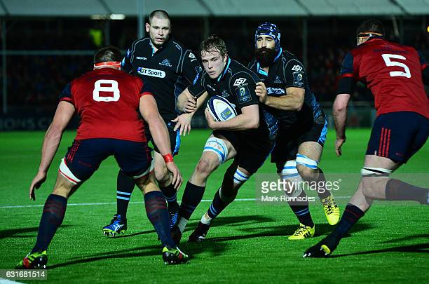 Jonny Grey of Glasgow Warriors is tackled by C J Stander and Donnacha Ryan during the European Rugby Champions Cup match between Glasgow Warriors and...
