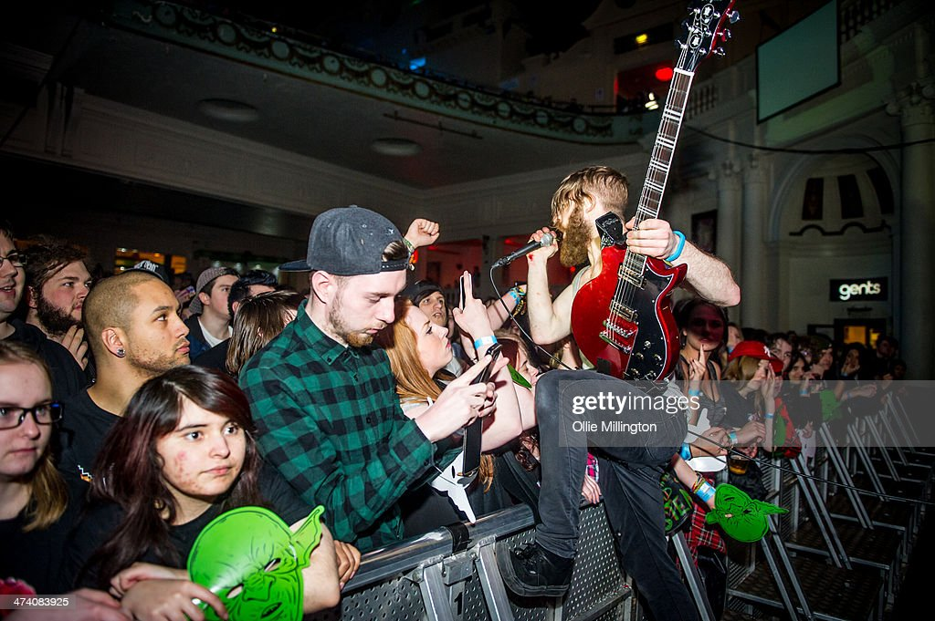 Jonny Hall of Baby Godzilla performs along the front row during the last night of the Kerrang Tourr at Brixton Academy on February 21, 2014 in London, United Kingdom.