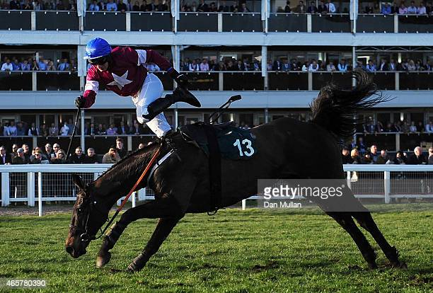 Jonny King is unseated from Thunder and Roses in The Toby Balding National Hunt Steeple Chase during Day One of the Cheltenham Festival at Cheltenham...