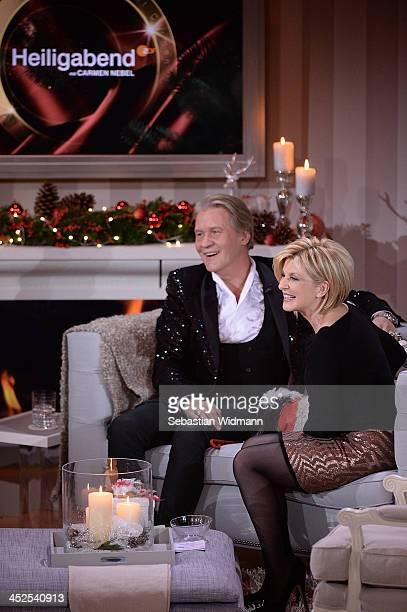 Jonny Logan and Carmen Nebel attend the 'Heiligabend mit Carmen Nebel' show taping at the Bavaria Studios on November 29 2013 in Munich Germany