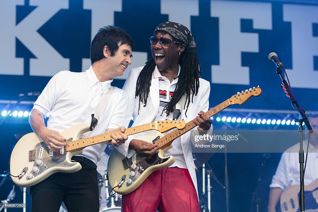 Jonny Marr and Nile Rodgers of Chic perform on stage during Park Life Festival at Platt Fields Park on June 9, 2012 in Manchester, United Kingdom.