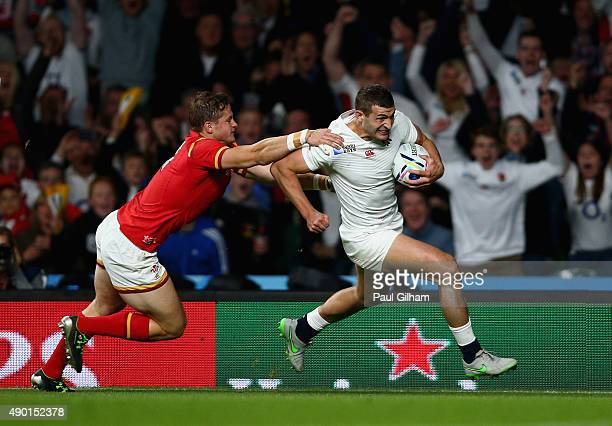 Jonny May of England beats Hallam Amos of Wales as he runs in to score their first try during the 2015 Rugby World Cup Pool A match between England...