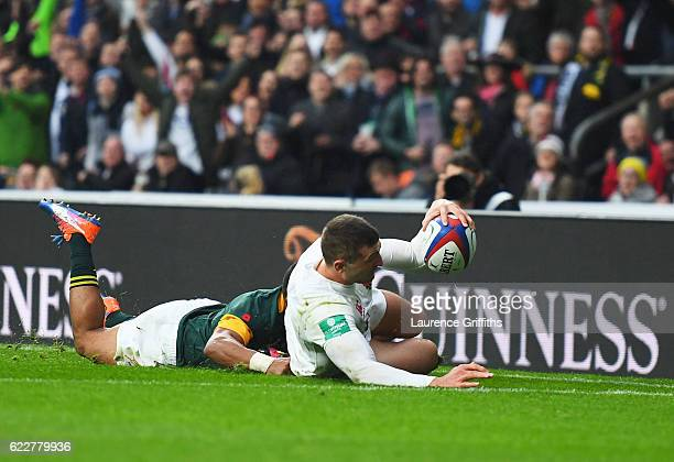Jonny May of England grounds the ball to score the first try during the Old Mutual Wealth Series match between England and South Africa at Twickenham...