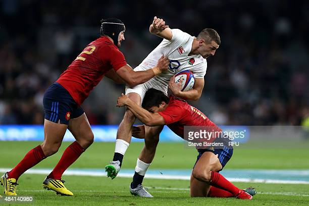 Jonny May of England is tackled by Alexandre Dumoulin and Francois TrinhDuc of France during the QBE International match between England and France...