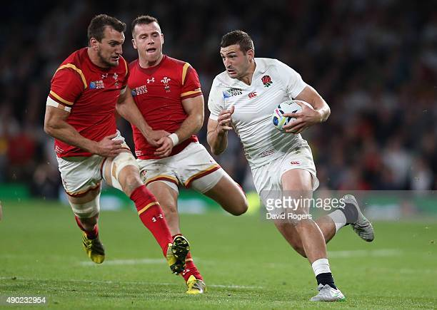 Jonny May of England moves away from Sam Warburton and Gareth Davies during the 2015 Rugby World Cup Pool A match between England and Wales at...