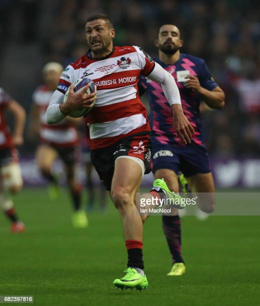 Jonny May of Gloucester breaks away to score the opening try during the European Rugby Challenge Cup Final between Gloucester and Stade Francais at...