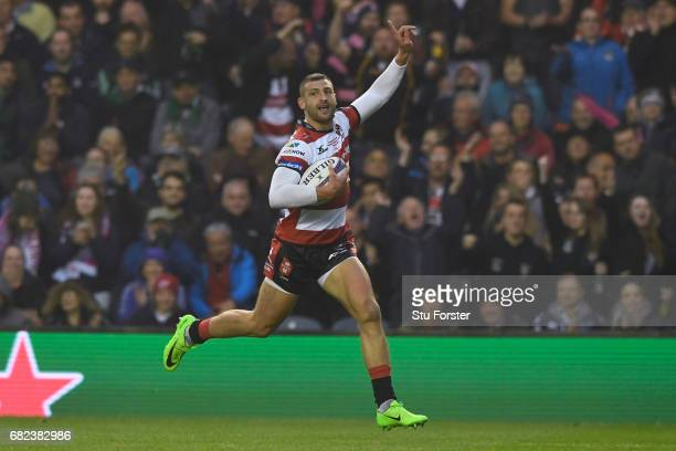 Jonny May of Gloucester celebrates as he runs in the opening try during the European Rugby Challenge Cup Final between Gloucester and Stade Francais...