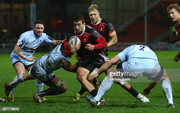 Jonny May of Gloucester cuts between Dan Sanderson and Ben Sowrey of Worcester during the European Rugby Challenge Cup Round Four match between...