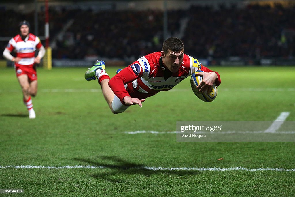 Jonny May of Gloucester dives over the line to score a try during the Aviva Premiership match between Gloucester and Harlequins at Kingsholm Stadium on March 29, 2013 in Gloucester, England.