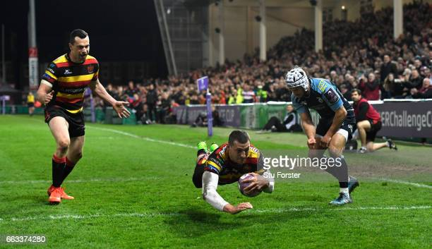 Jonny May of Gloucester dives over to score during the European Rugby Challenge Cup match between Gloucester Rugby and Cardiff Blues at Kingsholm on...